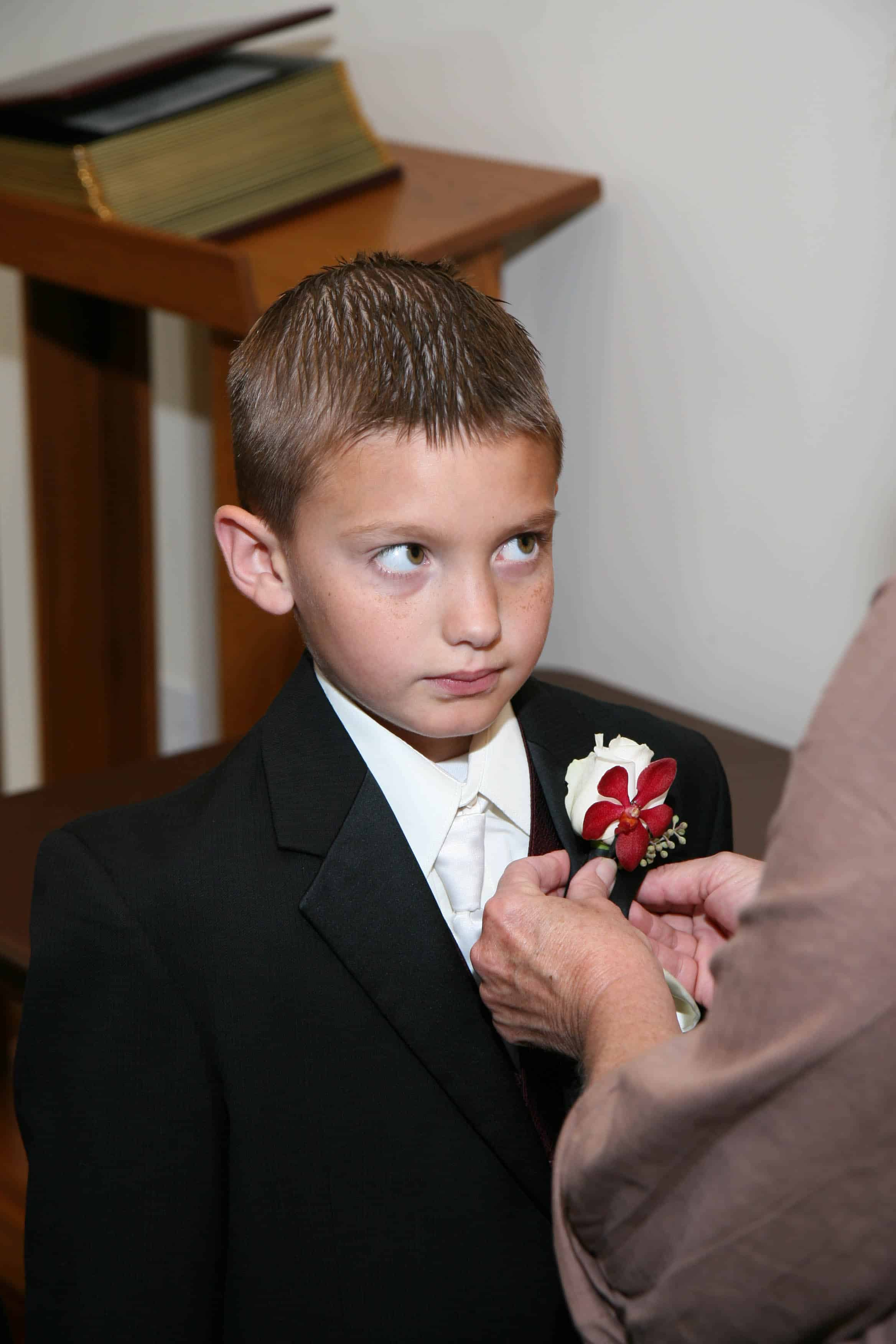 boy with flower being pinned on