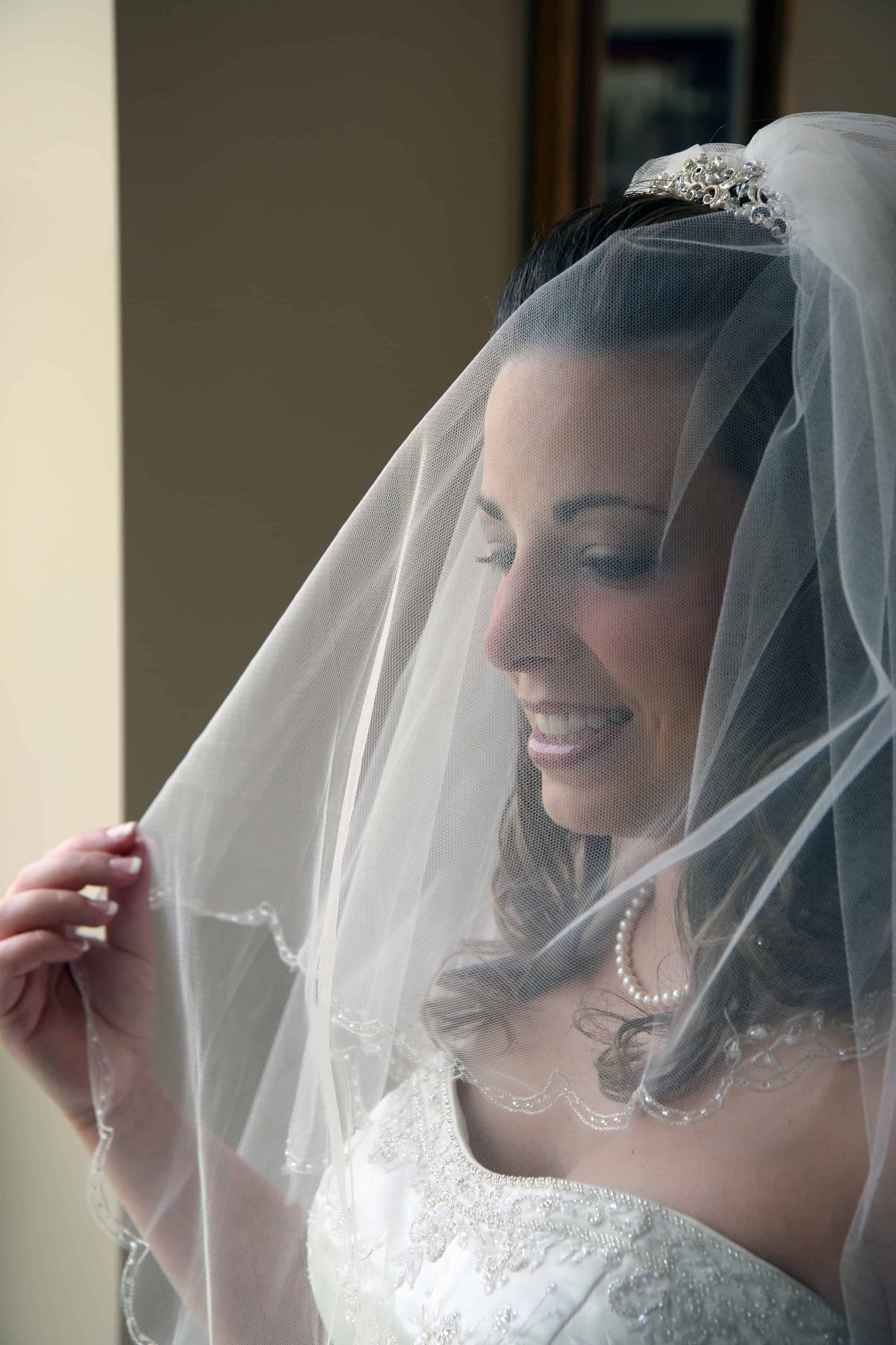 bride alone under veil
